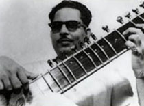 Mushtaq Ali Khan in his prime, playing sitar.